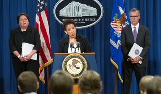 Attorney General Loretta Lynch (center), flanked by Assistant Attorney General Leslie Caldwell, Criminal Division (left) and FBI Assistant Director Andrew McCabe, announces guilty pleas from four large banks for their manipulation of global currency markets. (Associated Press)