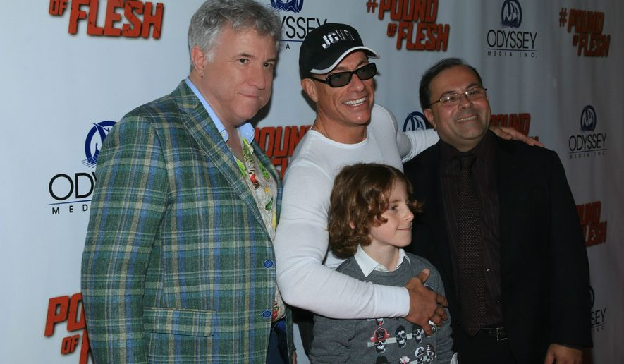 "From left: ""Pound of Flesh"" producer Kirk Shaw, star Jean-Claude Van Damme, co-star James Houghton and director Ernie Barbarash greet media and fans."