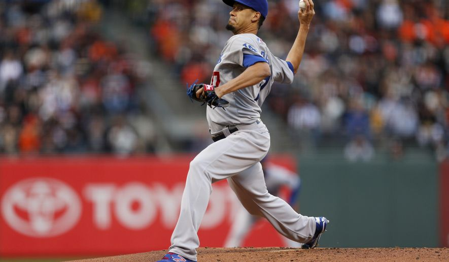 Los Angeles Dodgers pitcher Carlos Frias winds up during the first inning of a baseball game against the San Francisco Giants, Tuesday, May 19, 2015, in San Francisco. (AP Photo/Beck Diefenbach)