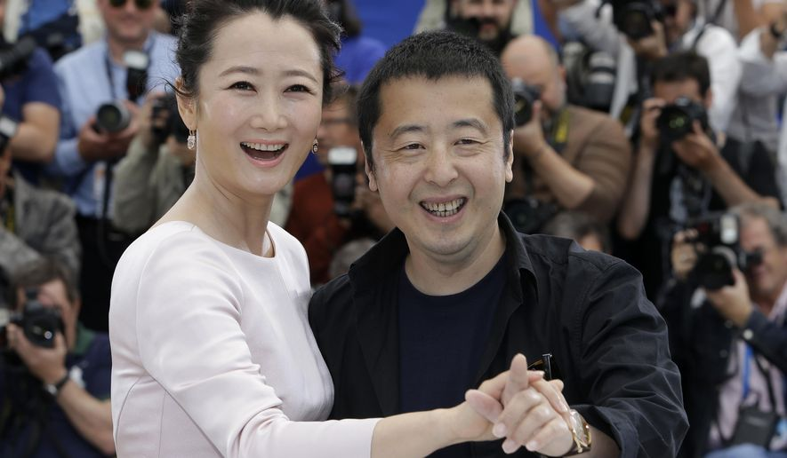 Actress Zhao Tao, left, and director Jia Zhangke pose for photographers during a photo call for the film Shan He Gu Ren (Mountains May Depart), at the 68th international film festival, Cannes, southern France, Wednesday, May 20, 2015. (AP Photo/Lionel Cironneau)