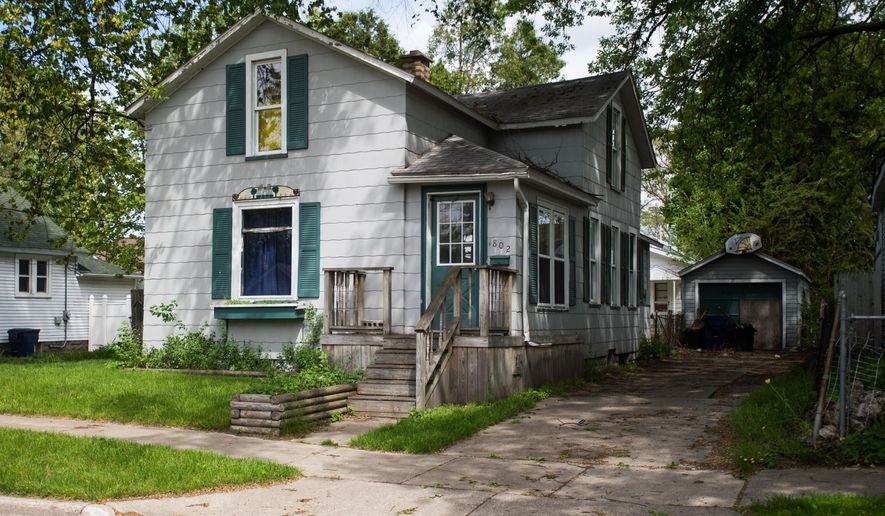 This photo taken May 18, 2015, shows the property that Bay City Commissioner Chad Sibley, 8th Ward, was arraigned on a charge of larceny after trying to clean up the yard in Bay City, Mich. The Bay City Times reported Tuesday, May 19, 2015, that Sibley was arraigned this month on larceny of $200 or less, which is punishable by up to 93 days in jail and a fine of $500 or three times the value of the property. (Yfat Yossifor/The Bay City Times via AP) LOCAL TELEVISION OUT; LOCAL INTERNET OUT (ONLN OUT; IONLN OUT)