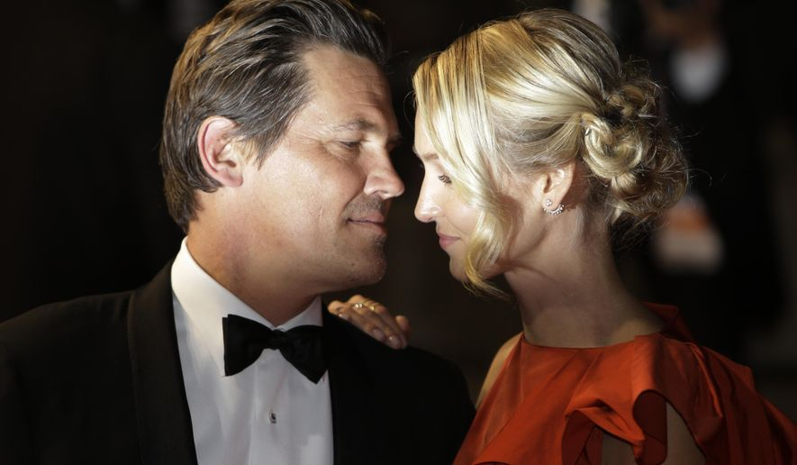 Actor Josh Brolin, left, and his partner Kathryn Boyd leave following the screening of the film Marguerite & Julien at the 68th international film festival, Cannes, southern France, Tuesday, May 19, 2015. (AP Photo/Lionel Cironneau)