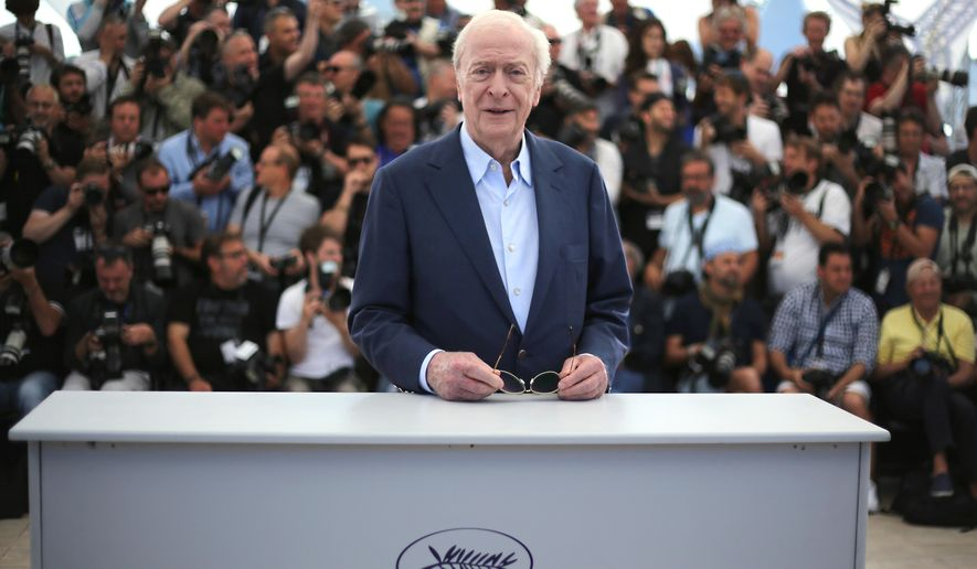 Michael Caine poses for photographers during a photo call for the film Youth, at the 68th international film festival, Cannes, southern France, Wednesday, May 20, 2015. (Photo by Joel Ryan/Invision/AP)