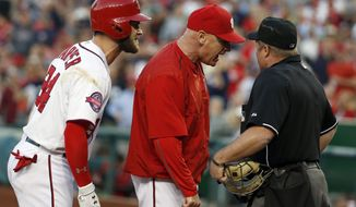 Washington Nationals' Bryce Harper (34) and manager Matt Williams (9) argue with home plate umpire Marvin Hudson during the third inning of a baseball game against the New York Yankees at Nationals Park, Wednesday, May 20, 2015, in Washington. Harper and Williams were ejected by Hudson. (AP Photo/Alex Brandon)
