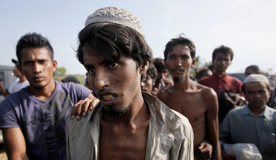 Rescued migrants arrive in Simpang Tiga, Aceh province, Indonesia Wednesday, May 20, 2015. Hundreds of migrants stranded at sea for months were rescued and taken to Indonesia, officials said Wednesday, the latest in a stream of Rohingya and Bangladeshi migrants to reach shore in a growing crisis confronting Southeast Asia. (AP Photo/Binsar Bakkara)