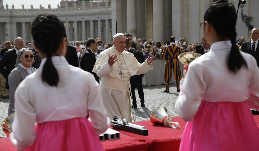 Members of a South Korean musical band perform as Pope Francis, center, arrives for his weekly audience, at the Vatican, Wednesday, May 20, 2015. (AP Photo/Andrew Medichini)