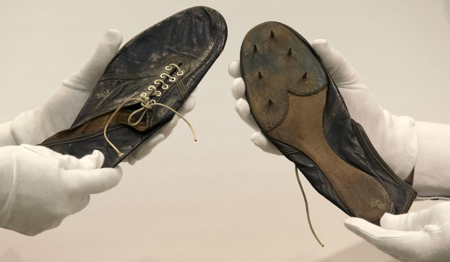 The running shoes worn by Britain's Roger Bannister, the first man to run a sub 4 minute mile, on display during a media viewing at Christie's auction house in London, Wednesday, May 20, 2015. Bannister, who ran a time of 3 mins 59.4 seconds on May 6, 1954, wore theses lightweight shoes in the race. They will be sold at auction on Sept. 10, with an estimated sale price of 30-50,000 pounds sterling (US$ 46,600-77,600). (AP Photo/Alastair Grant)
