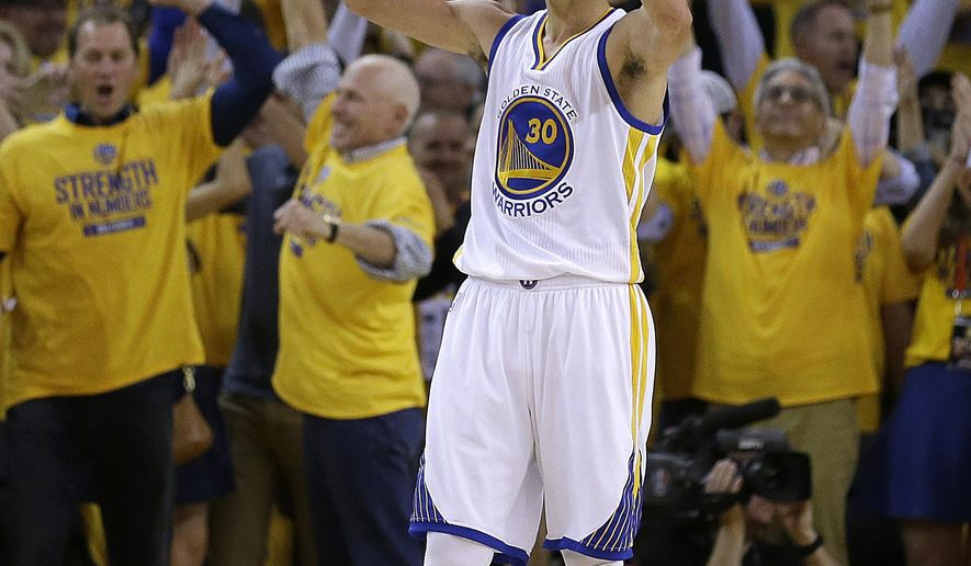 Golden State Warriors' Stephen Curry celebrates the Warriors' 110-106 defeat of the Houston Rockets at the end of Game 1 of the NBA basketball Western Conference finals in Oakland, Calif., Tuesday, May 19, 2015. (AP Photo/Ben Margot)