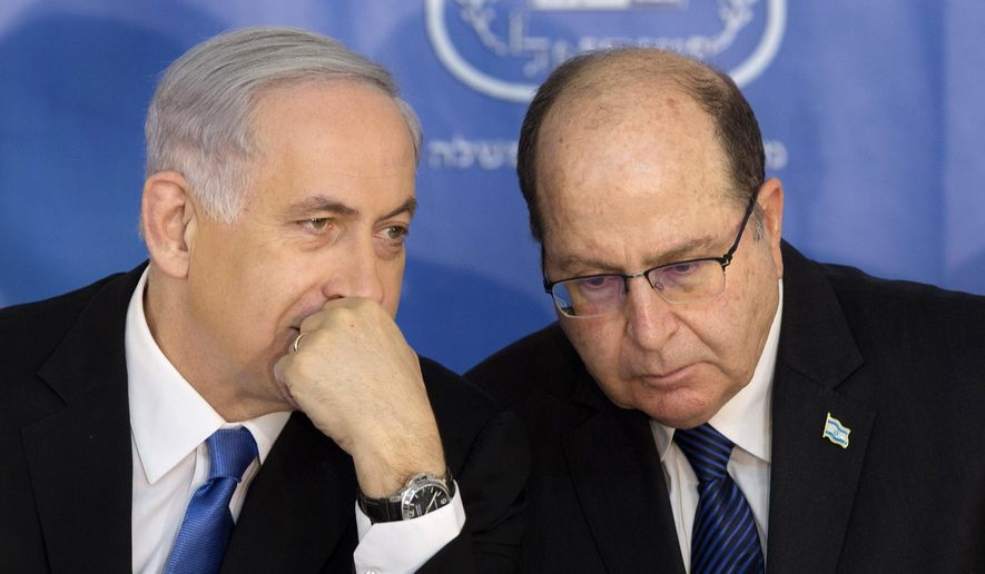 In this Feb. 16, 2015 photo, Israeli Prime Minister Benjamin Netanyahu, left, speaks with Israel's Defense Minister Moshe Yaalon during a ceremony for new Israeli Chief of Staff Gadi Eizenkot at the Prime Minister's office in Jerusalem. Netanyahu on Wednesday, May 20, 2015, called off a proposed plan to segregate Palestinians from Israelis on West Bank buses, overruling his defense minister amid a flurry of criticism in an attempt to avert the first crisis of his new government. Thousands of Palestinians enter Israel for work each day from the West Bank and often return home in buses alongside Jewish settlers. (AP Photo/Sebastian Scheiner, File)