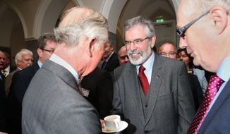 Britain's Prince Charles. left, shakes hands with Sinn Fein president Gerry Adams at the National University of Ireland in Galway, Ireland, Tuesday May 19, 2015. (Brian Lawless/Pool photo via AP)
