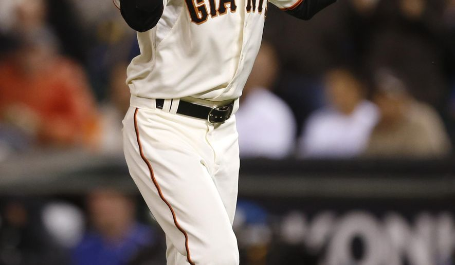 San Francisco Giants pitcher Sergio Romo celebrates after getting the final out of the top of the seventh inning against the Los Angeles Dodger with the bases loaded, Tuesday, May 19, 2015, in San Francisco. (AP Photo/Beck Diefenbach)