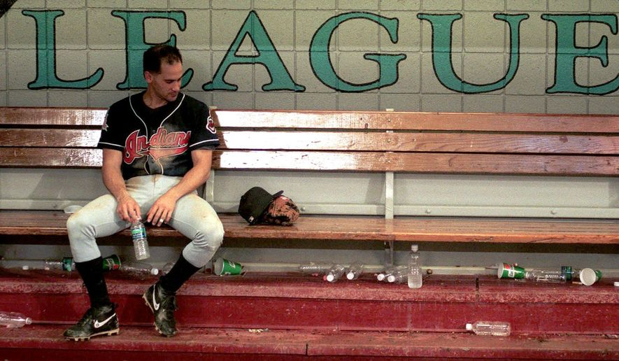 FILE - In this Oct. 27, 1997, file photo, Cleveland Indians shortstop Omar Vizquel sits dejectedly in the dugout after the Indians lost to the Marlins 3-2 in Game Seven of the World Series at Pro Player Stadium in Miami. On the sports misery index, Atlanta and Cleveland are hard to beat. The two cities have combined for one championship over the last half-century  - and that came in 1995, when the Atlanta Braves beat the Cleveland Indians in the World Series. (Roadell Hickman/The Cleveland Plain Dealer via AP, File) NO SALES. MANDATORY CREDIT