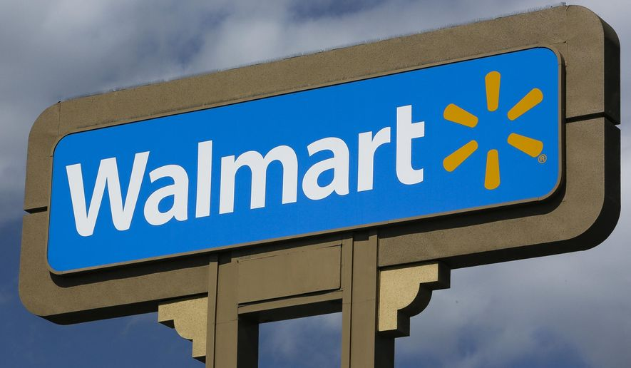 This May 28, 2013, file photo shows signage outside a Wal-Mart store in Duarte, Calif. (AP Photo/Damian Dovarganes, File)