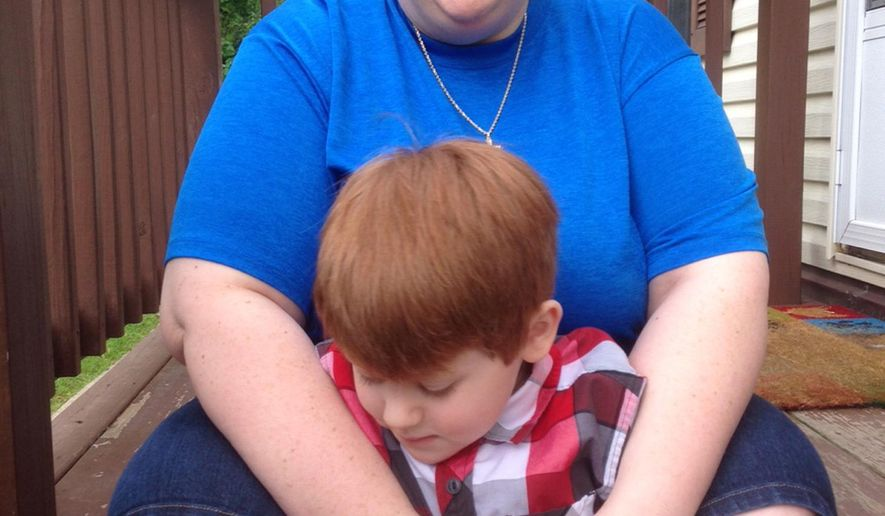 Lisa Smith sits on her porch, with son Noah, at their home  Belleville, Mich., Tuesday, May 19, 2015. Noah is registered to use marijuana to control epileptic seizures; the effect on his autism was an unexpected benefit. Based on that success, Smith is asking the state of Michigan to add autism to the list of conditions that qualify for medical marijuana. A public hearing will be held in Lansing on May 27.  (AP Photo/Ed White)