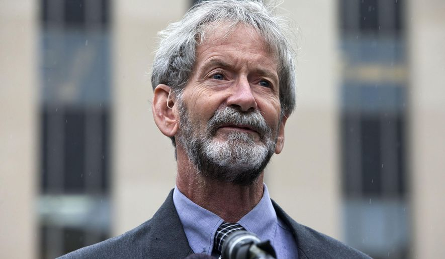 Douglas Hughes of Florida speaks to reporters outside federal court in Washington, Thursday, May 21, 2015. Hughes, who flew a gyrocopter through some of America's most restricted airspace before landing at the Capitol pleaded not guilty on Thursday to the six charges he faces. (Associated Press) **FILE**