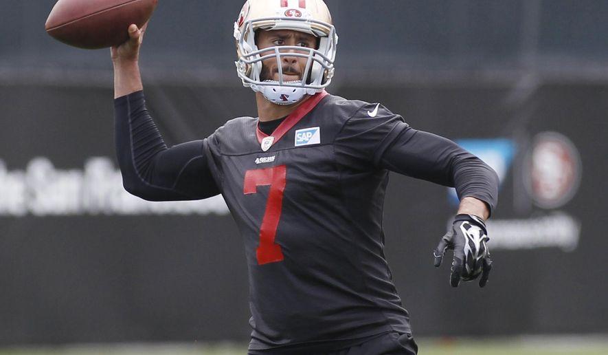 San Francisco 49ers quarterback Colin Kaepernick throws the ball during NFL football practice, Thursday, May 21, 2015, in Santa Clara, Calif. (AP Photo/George Nikitin)