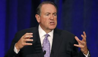 Republican presidential candidate and former Arkansas Gov. Mike Huckabee speaks in Scottsdale, Ariz., in this May 15, 2015, file photo. (AP Photo/Ross D. Franklin, File)