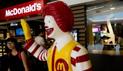 McDonald's CEO Steve Easterbrook assured shareholders on Thursday that the hamburger chain's famed spokesclown, Ronald McDonald, will not be given the pink slip. Several in attendance raised concerns about how Ronald's appeal directly markets fast-food fare to children. (Associated Press)