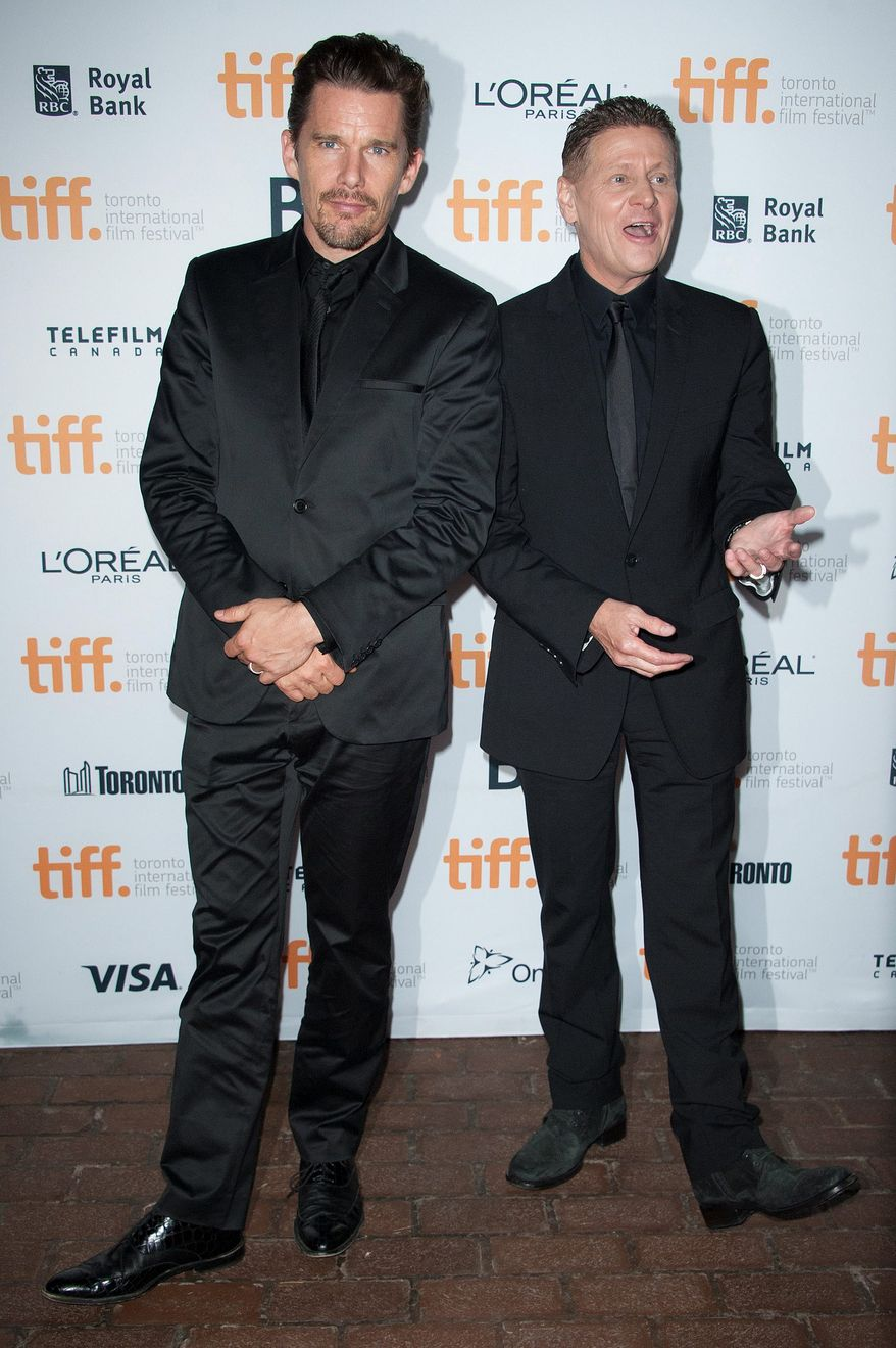 """Actor Ethan Hawke and director Andrew Niccol seen at the premiere of """"Good Kill"""" at the Ryerson Theatre during the 2014 Toronto International Film Festival on Tuesday, Sept. 9, 2014, in Toronto. (Photo by Arthur Mola/Invision/AP)"""