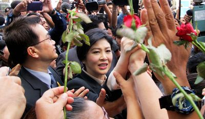 """On Tuesday, former Thai prime minister Yingluck Shinawatra posted $900,000 bail and pleaded not guilty to """"dereliction of duty"""" charges resulting from the administration of rice crop subsidies that cost billions of dollars during her 2011-2014 administration. (Associated Press)"""