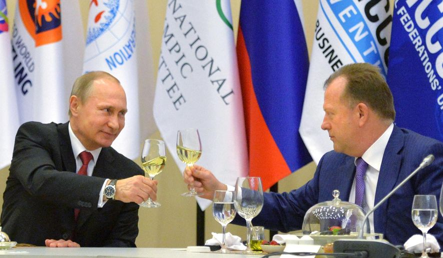 FILE - In this Monday, April 20, 2015 file photo, Russian President Vladimir Putin, left, toasts with Marius Vizer, head of IFJ and SportAccord Convention president, during a reception in Sochi, Russia.  The head of umbrella body SportAccord has issued Thursday May 21 2015 a 20-point plan for discussions with the IOC, including the introduction of prize money for Olympic athletes. Marius Vizer also seeks a 50 percent share for all federations in the IOC's new Olympic television channel, and wants all non-Olympic federations to be allowed to demonstrate their sport before or after each games in the host city.  (Alexei Druzhinin/RIA Novosti, Kremlin Pool Photo via AP, File)