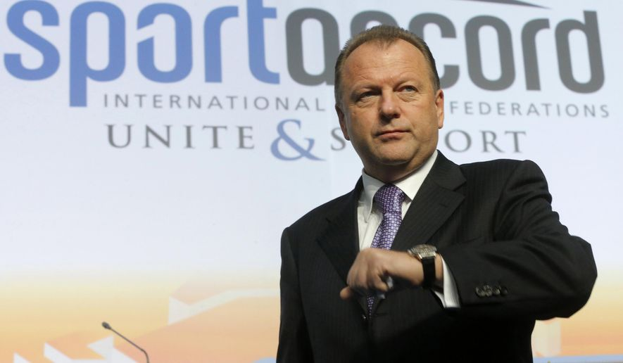 FILE - In this Friday, May 31, 2013 file photo, Marius Vizer, president of the International Judo Federation, (IJF) attends the SportAccord International Convention in St. Petersburg, Russia. The head of umbrella body SportAccord has issued Thursday May 21 2015 a 20-point plan for discussions with the IOC, including the introduction of prize money for Olympic athletes. Marius Vizer also seeks a 50 percent share for all federations in the IOC's new Olympic television channel, and wants all non-Olympic federations to be allowed to demonstrate their sport before or after each games in the host city. (AP Photo/Dmitry Lovetsky, File)