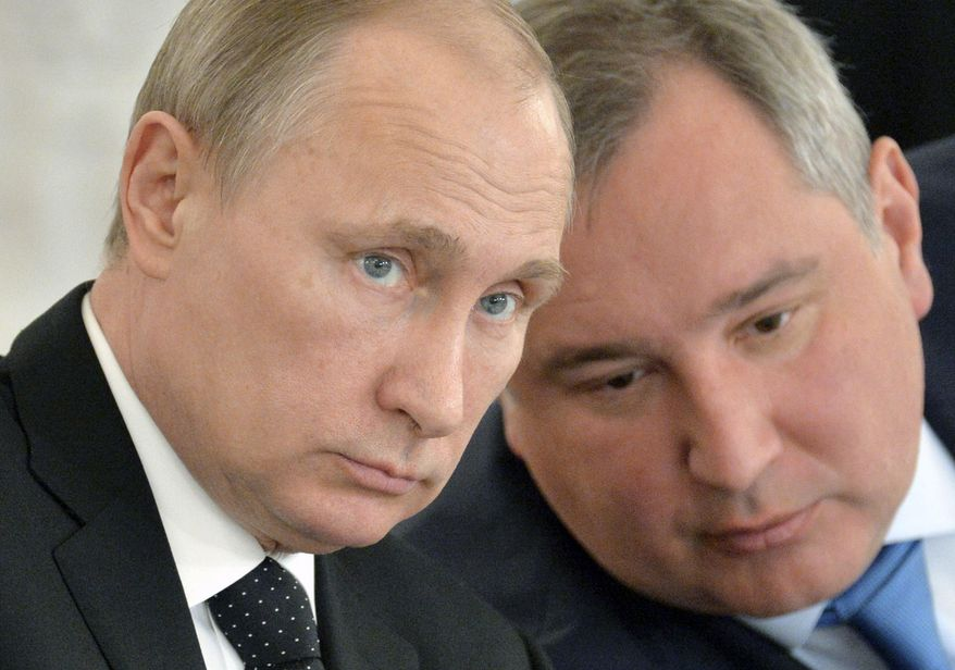 Russian President Vladimir Putin, left, and Deputy Prime Minister Dmitry Rogozin attend a meeting of the Victory Day celebrations organizing committee in the Kremlin in Moscow, Russia, in this March 17, 2015, file photo. (Alexei Druzhinin/RIA Novosti, Kremlin Pool Photo via AP, File)