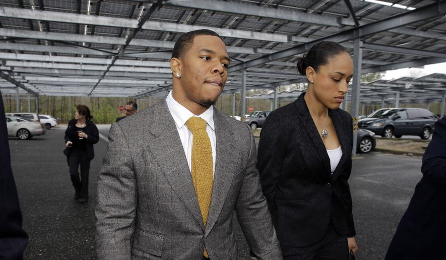 Ray Rice holds hands with his wife Janay Palmer as they arrive at Atlantic County Criminal Courthouse in Mays Landing, N.J., on May 1, 2014. A judge in New Jersey has dismissed domestic violence charges against Ray Rice, who was captured by a surveillance camera knocking his then-fiancee unconscious in a hotel elevator. Judge Michael Donio dismissed the charges on May 21, 2015, after the Atlantic County prosecutor told him the former Baltimore Ravens running back had completed the terms of his pretrial intervention. (Associated Press) **FILE**