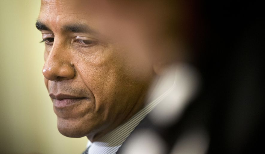 President Barack Obama listens to the translations of remark made by Tunisian President Beji Caid Essebsi during their meeting in the Oval Office of the White House in Washington, Thursday, May 21, 2015. (AP Photo/Pablo Martinez Monsivais)
