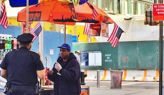 Ahmed Mohammed, a New York City hot dog vendor caught on camera selling $30 hot dogs outside the World Trade Center, could reportedly face up to $1,500 in fines after police handed him three summonses on Wednesday. (Twitter/@NYPD1Pct)