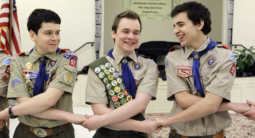 In this Monday, Feb. 10, 2014, file photo, Pascal Tessier, center, takes part in an activity with fellow scouts Matthew Huerta, left, and Michael Fine, right, after he received his Eagle Scout badge in Chevy Chase, Md. On Thursday, April 2, 2015, the Boy Scouts' New York chapter announced it hired Mr. Tessier as the nation's first openly gay Eagle Scout as a summer camp leader in public contrast to the national scouting organization's ban on openly gay adult members. (AP Photo/Luis M. Alvarez/File)