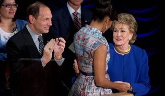 Veterans Affairs Secretary Robert McDonald, first lady Michelle Obama and former Sen. Elizabeth Dole gave a special salute to veterans' caregivers during a Hidden Heroes Coalition Summit in May 2015. (Associated Press)