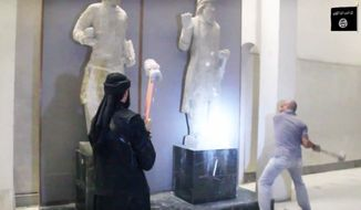 FILE - In this image made from video posted on a social media account affiliated with the Islamic State group on Thursday, Feb. 26, 2015, which has been verified and is consistent with other AP reporting, militants attack ancient artifacts with sledgehammers in the Ninevah Museum in Mosul, Iraq. Islamic State militants have looted and vandalized the museum in Mosul, Iraq's 2nd largest city, and have massively damaged the ancient cities of Hatra and Ninevah both UNESCO world heritage sites. (AP Photo via militant social media account, File)