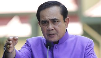 "Thailand's Prime Minister Prayuth Chan-ocha publicly shrugs off international criticism of his May 22, 2014, coup and his junta's military trials and coercive ""attitude-adjustment"" confinement for civilian dissidents. (Associated Press)"