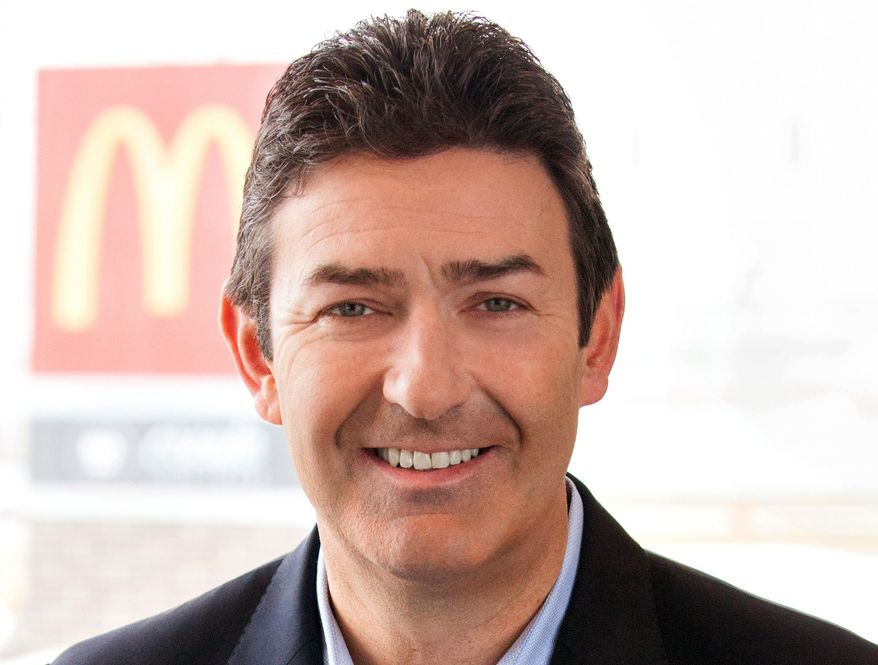 In this January 2015 photo provided by McDonald's, company President and CEO Steve Easterbrook poses for a photo. Easterbrook is set to make his debut before shareholders at the company's annual meeting Thursday, May 21, 2015, at a time when the chain is facing declining sales and ongoing protests. (McDonald's via AP)