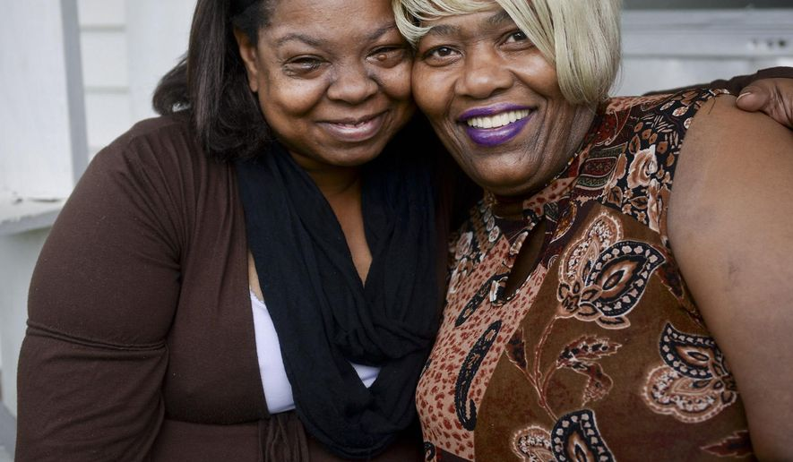ADVANCED FOR RELEASE SUNDAY, MAY 24, 2015 Antoinette Little, left, and Elaine Green Luke, both survivors of domestic violence who help other women in their community, pose for a photo, May 1, 2015, in Winston-Salem, N.C. (Lauren Carroll/Winston-Salem Journal via AP)