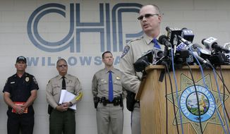 In this April 11, 2014, file photo, California Highway Patrol Lt. Commander Bruce Carpenter, right, speaks at a news conference in Willows, Calif. (AP Photo/Jeff Chiu, File)