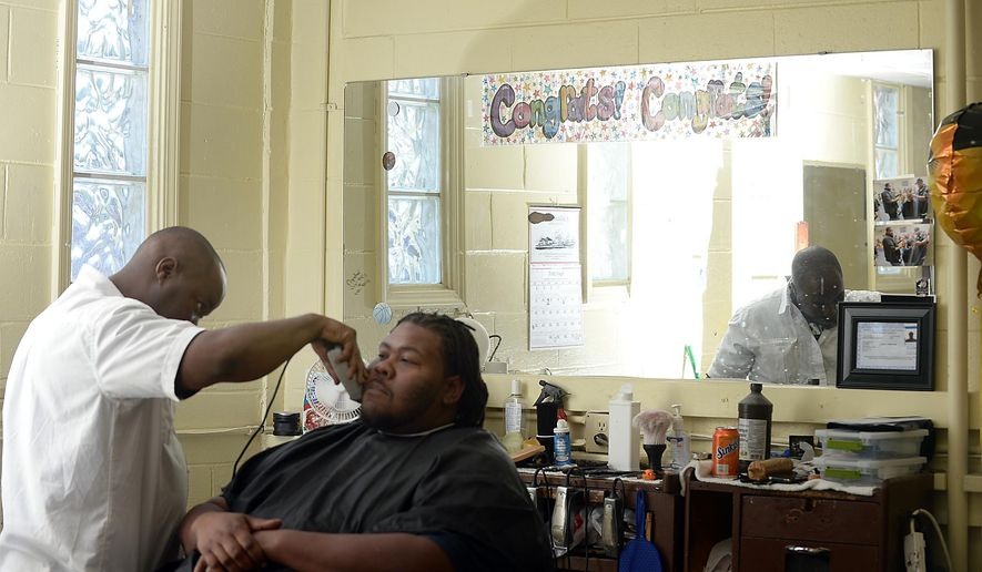 ADVANCE FOR USE TUESDAY, MAY 26 - In this photo taken April 24, 2015, James Proctor talks about his life while giving a haircut at the Southside Barbershop in Spartanburg, S.C. Proctor recently received a license to barber. He apprenticed with Daniel Jones, who has continued a legacy his father began by helping ex-offenders learn a trade that enables them to make a livelihood. (Alex Hicks Jr./The Spartanburg Herald-Journal via AP)