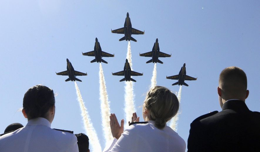 The Blue Angels flight demonstration team flies over graduating members of the U.S. Naval Academy during a graduation and commissioning ceremony, Friday, May 22, 2015, in Annapolis, Md. (AP Photo/Patrick Semansky) ** FILE **
