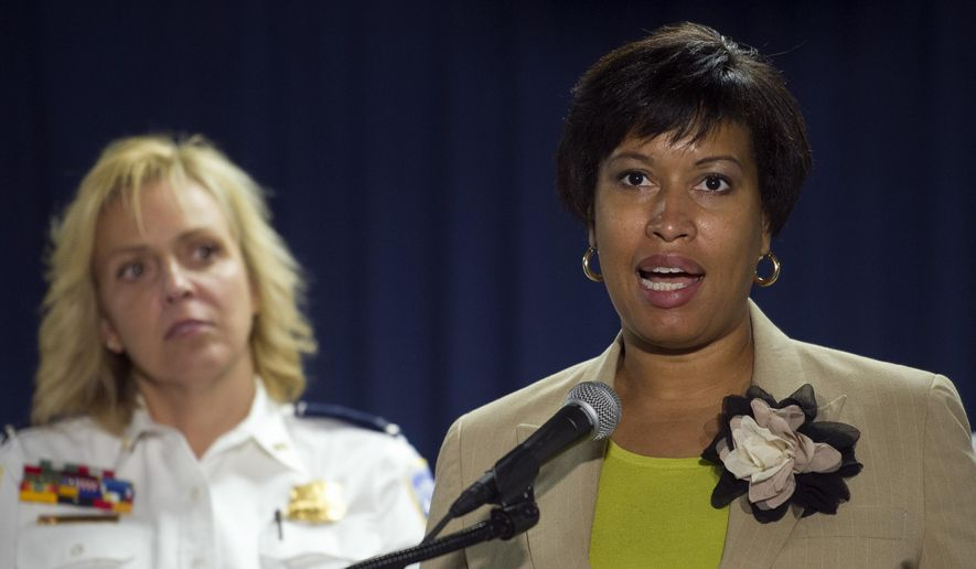 Washington Mayor Muriel Bowser, right, and Police Chief Cathy Lanier, participate in a news conference in Washington, Thursday, May 21, 2015, to discuss the investigation into the mysterious slayings of a wealthy Washington family and their housekeeper. Lanier said investigators believe a suspect in the slayings is in the Brooklyn area of New York City.  (AP Photo/Cliff Owen) **FILE**