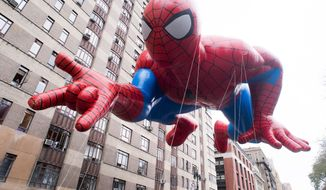 The Spider-Man balloon floats in the Macy's Thanksgiving Day Parade on Thursday, Nov. 27, 2014 in New York. (Photo by Charles Sykes/Invision/AP)