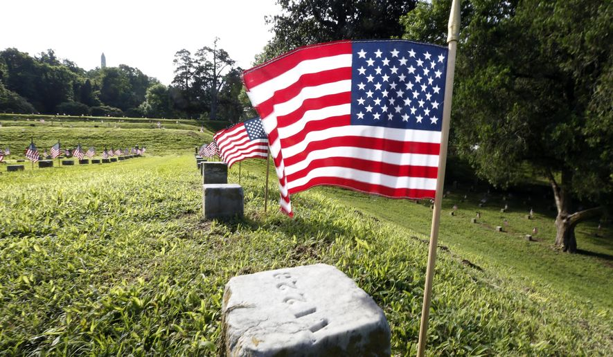 American flags were placed on the graves of American servicemen in the Vicksburg National Cemetery in Vicksburg, Miss., Friday, May 22, 2015, in advance of the Memorial Day weekend. (AP Photo/Rogelio V. Solis, file) ** FILE **