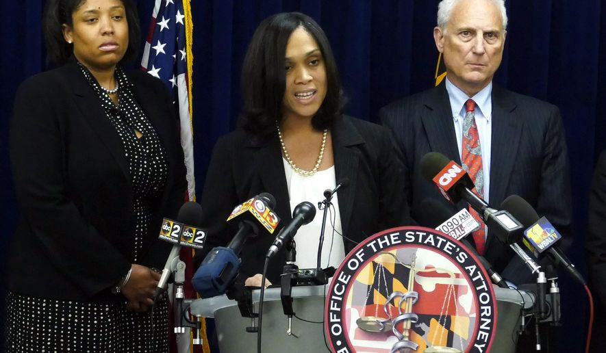 """Baltimore States Attorney Marilyn Mosby announces the indictments of six Baltimore Police officers Thursday, May 21, 2015,  on various charges related to the arrest and death of Freddie Gray. The indictments were very similar to the charges Mosby announced about three weeks ago. The most serious charge for each officer, ranging from second-degree """"depraved heart"""" murder to assault, still stood. (Kevin Richardson/The Baltimore Sun via AP)"""