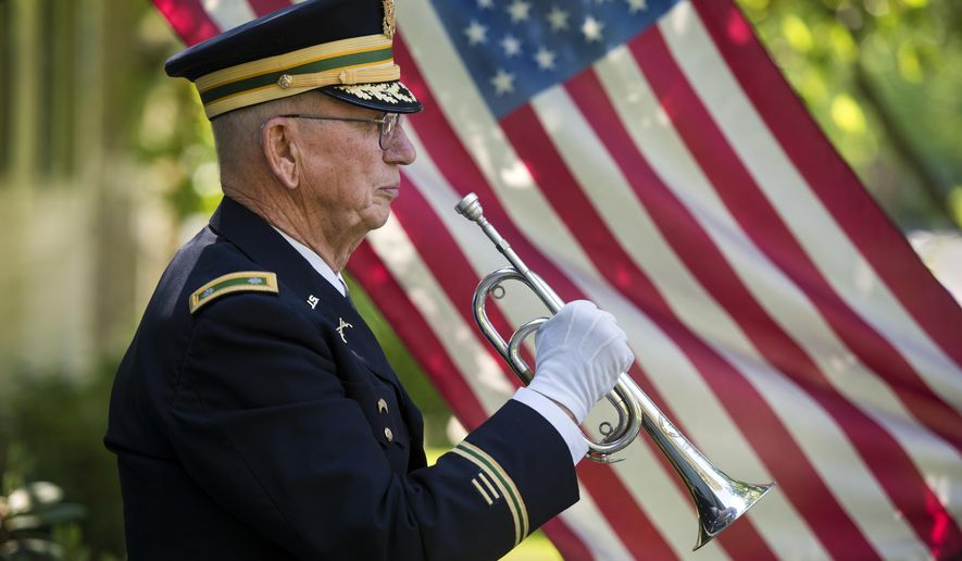 "This May 21, 2015 photo shows Ltc. USAR (Ret) Phil Kowzan of Spokane, Wash. Since 2001, he has played taps at 1,259 military honor funerals in the Spokane-area. And his service is in increasingly high demand. Kowzan, 77, knows of only three other bugler players and it's not unusual for him to play for three funerals in the morning, and another three in the afternoon. ""I did seven one day,"" he says. ""That's a lot."" (Dan Pelle/The Spokesman-Review via AP)"