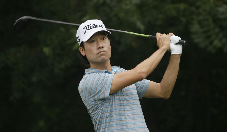 Kevin Na watch his tee shot on the sixth hole during the third round of the Colonial golf tournament Saturday, May 23, 2015, in Fort Worth, Texas. (AP Photo/LM Otero)