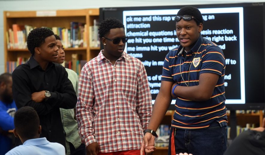 Dalewood Middle students Tahj Cargle, Jamaal Ward, Eric Kelly and Jamicheal Wilson, from left, perform a science rap song for 7th graders Wednesday, May 20, 2015, at the school.  The four Dalewood Middle School students comprise the rap group Re-Generation, and on May 20 they were performing for the seventh-grade students at their end-of-the-year awards ceremony in the school's media center. The group has gained some fame of late, appearing on local radio and winning a regional competition at Chattanooga State Community College. (Angela Lewis Foster/Chattanooga Times Free Press via AP)