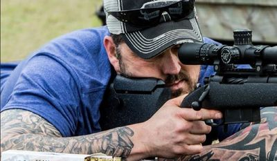 Former Navy SEAL Marcus Luttrell shoots Team Never Quit training rounds. (Image: Facebook, Team Never Quit) ** FILE **
