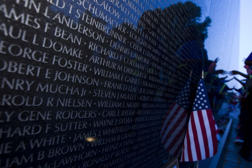 Visitors Touch The Names At The Wall Of Vietnam Veterans Memorial During A Memorial  Day Candlelight
