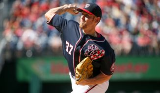 Washington Nationals starting pitcher Stephen Strasburg (37) throws in the first inning of a baseball game against the Philadelphia Phillies, Saturday, May 23, 2015, at Nationals Park in Washington. (AP Photo/Andrew Harnik)