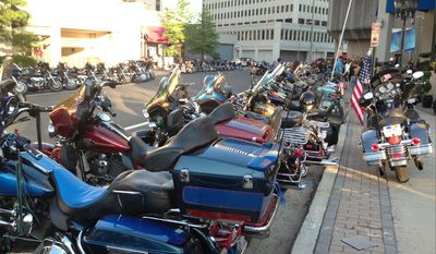 Saturday night with Rolling Thunder: lots of Harleys, good will, dedication (Photo by Jennifer Harper/The Washington Times)